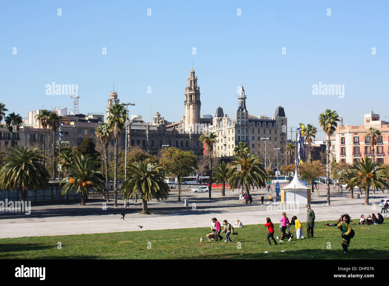Children playing on green field in Barcelona, Spain Stock Photo
