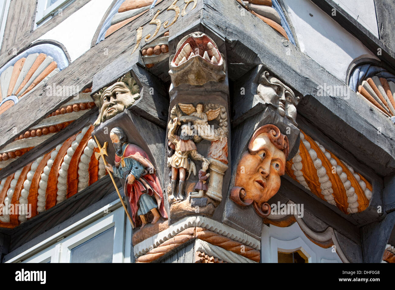 Binding of Isaac , Ornately carved architectural detail of Stiftsherrenhaus, 1558, Osterstrasse, Hameln, Lower Saxony, - Stock Image