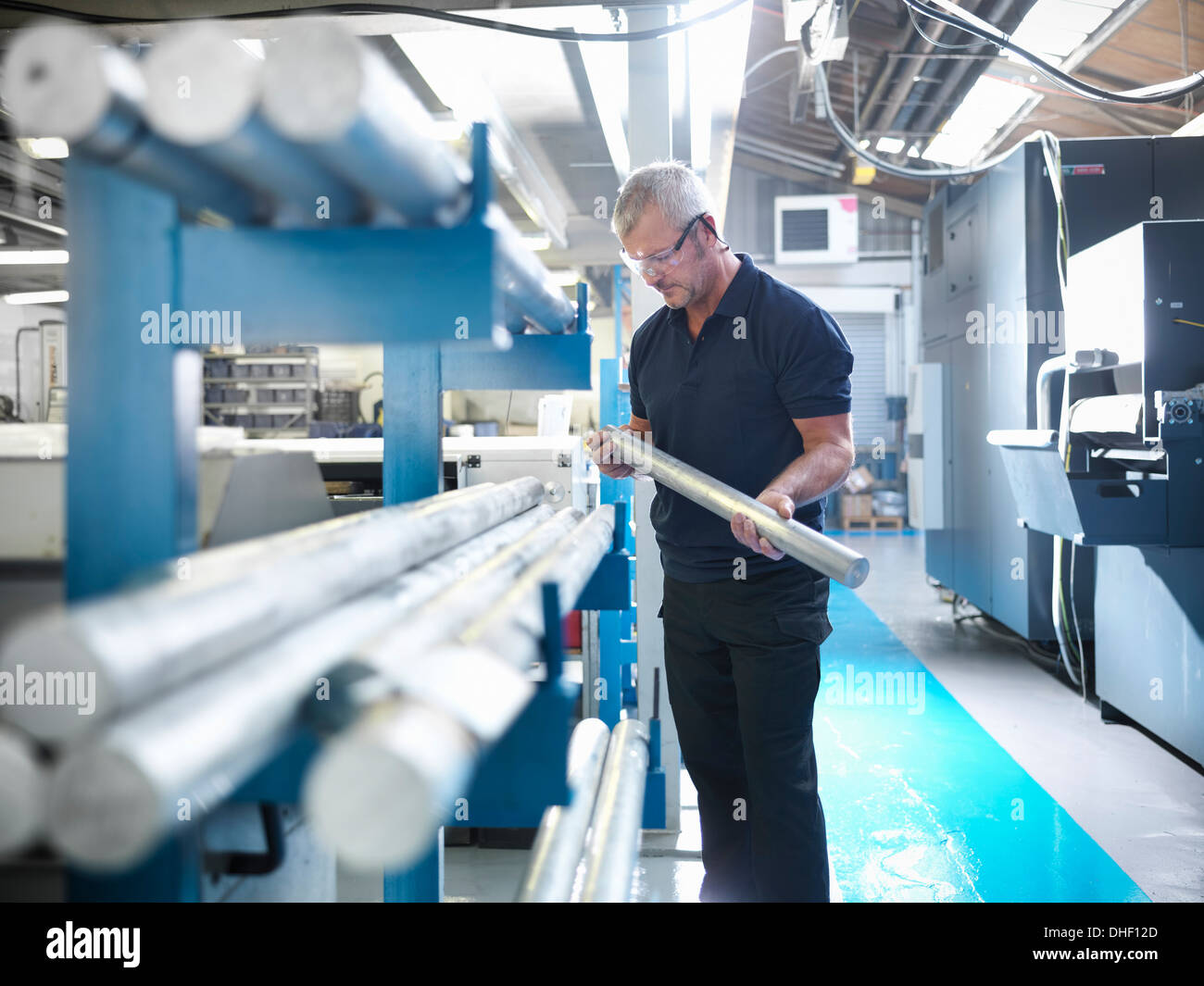 Engineer working with aluminium in factory - Stock Image