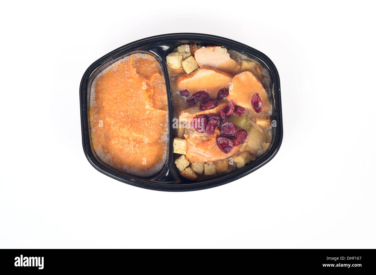 Frozen tray of turkey, stuffing and cranberries with butternut squash - Stock Image
