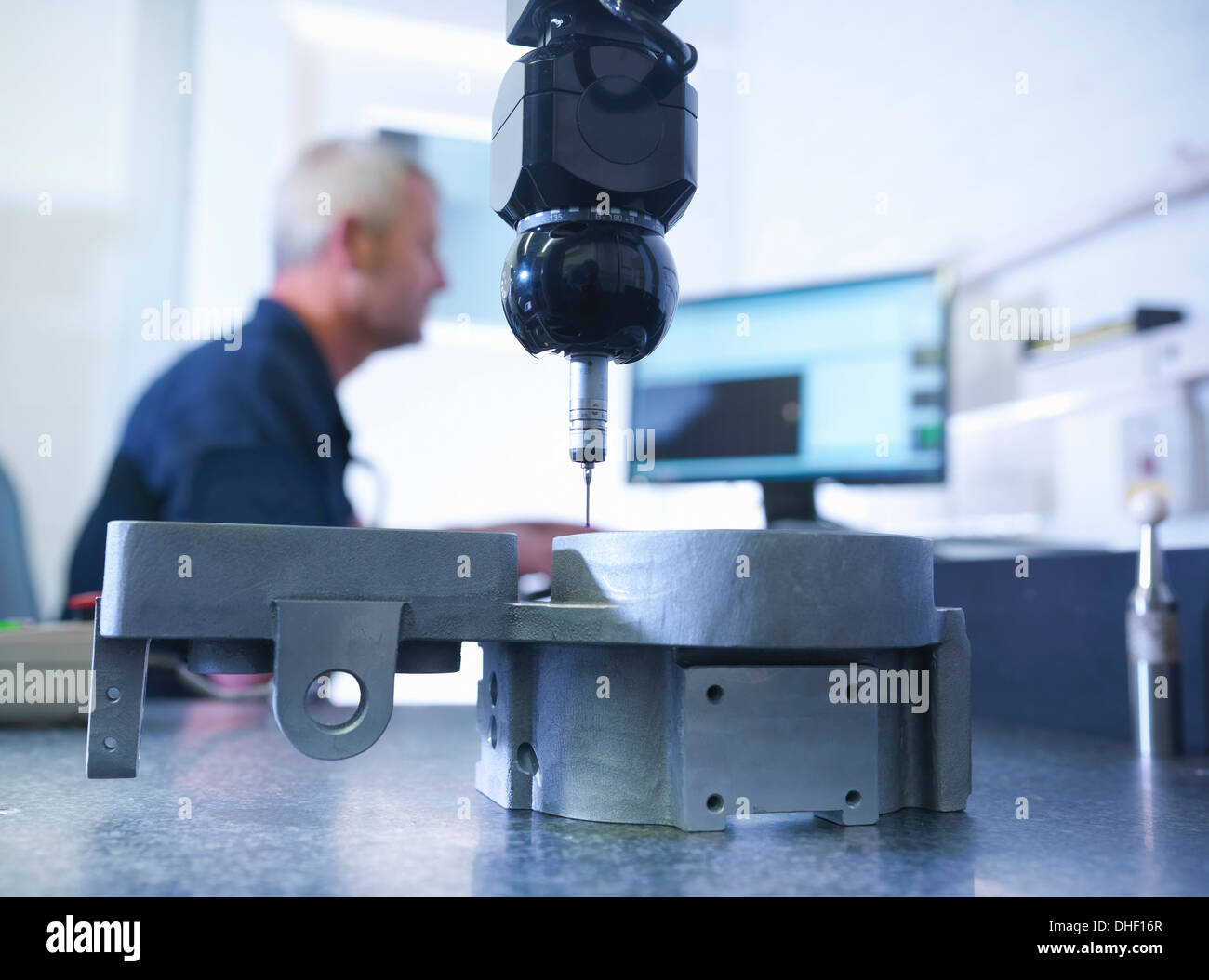 Engineer measuring components in factory - Stock Image