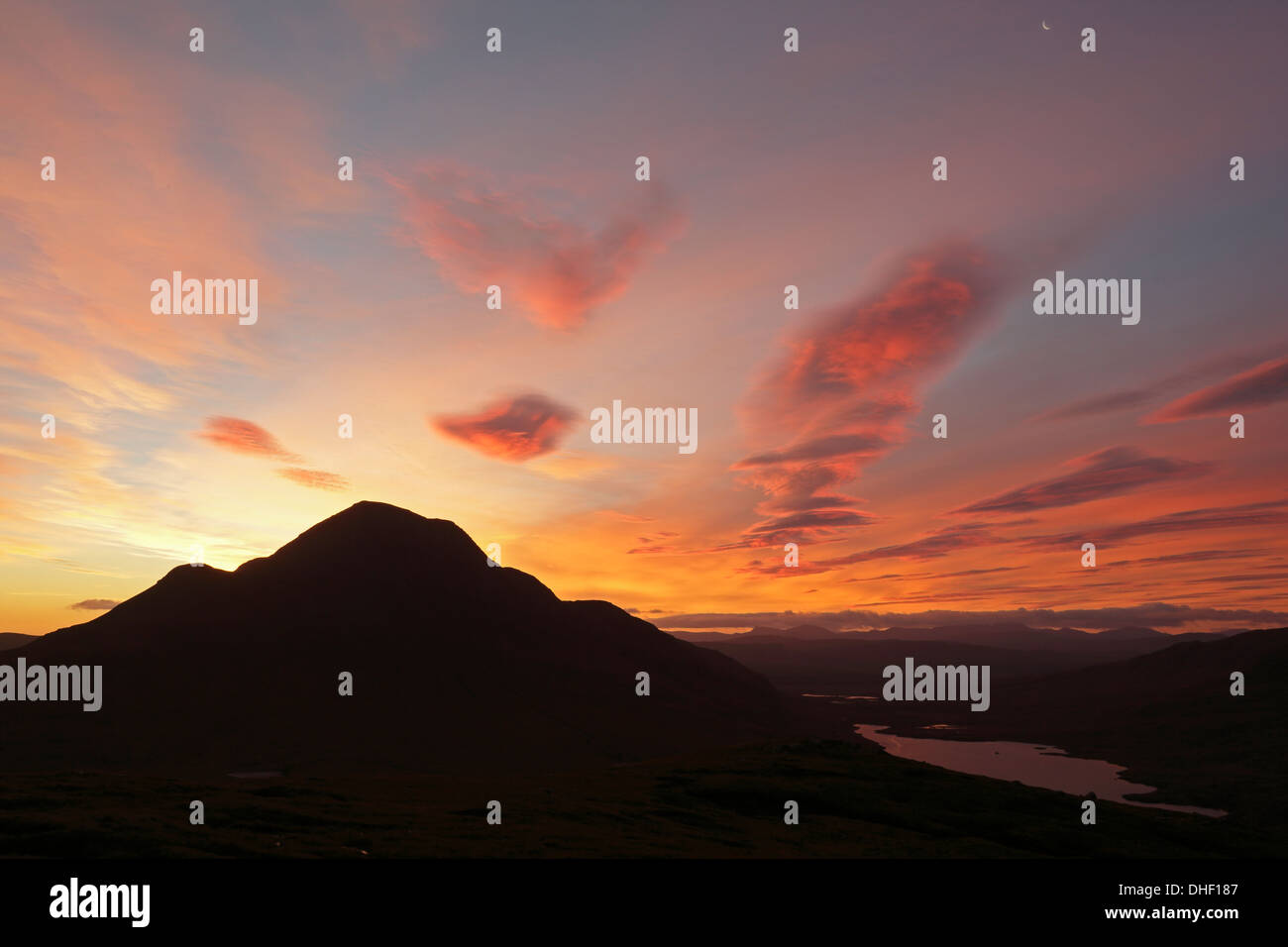 Sunrise over Cul Beag from Stac Pollaidh - Stock Image
