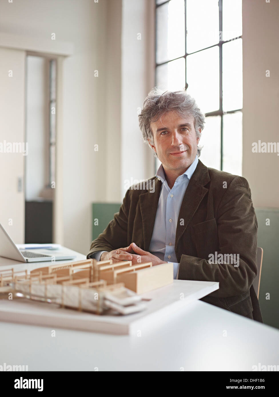 Male architect with model Stock Photo