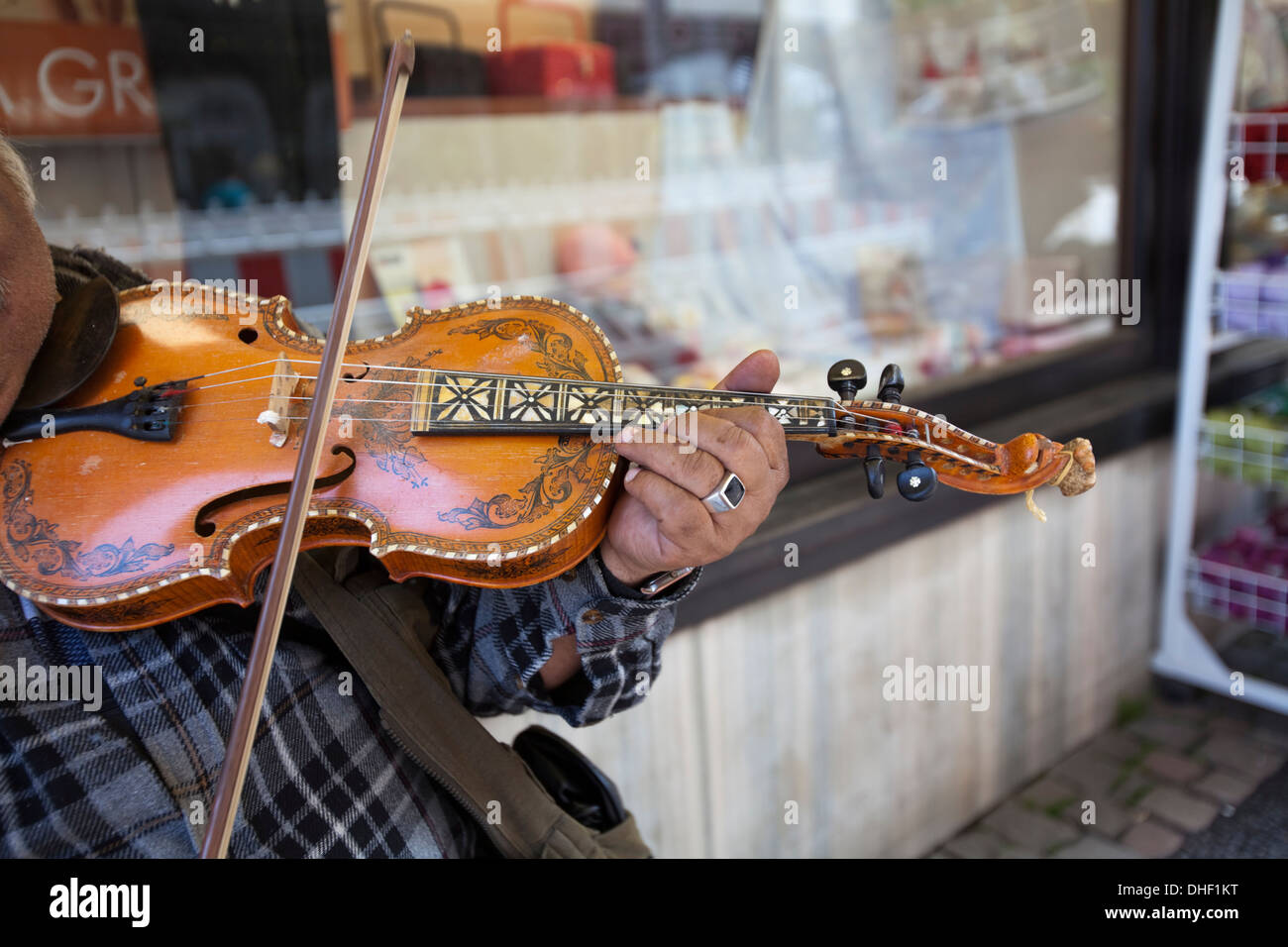 street musician, playing a violin - Stock Image