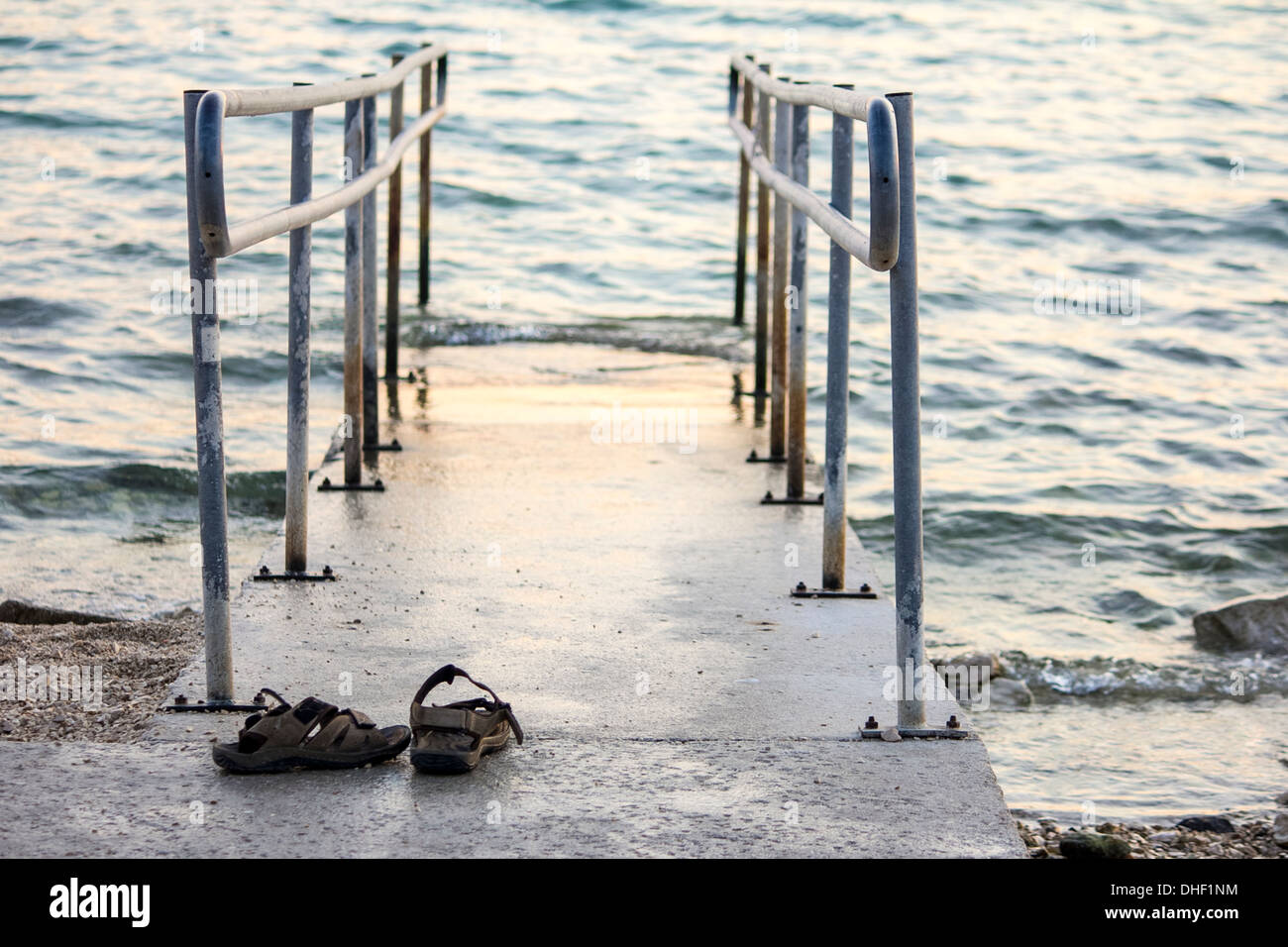 Sandals on disability access to the sea - Stock Image