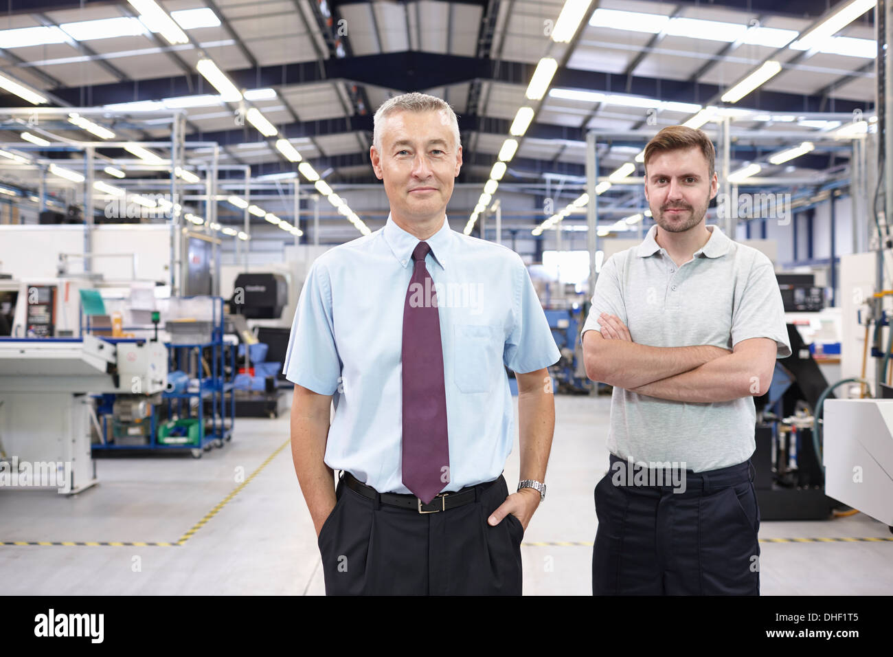 Portrait of manager and co-worker in engineering factory - Stock Image