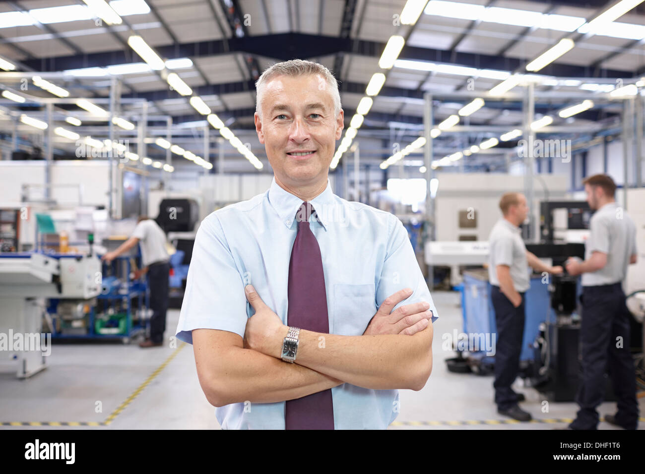 Portrait of manager in engineering factory - Stock Image