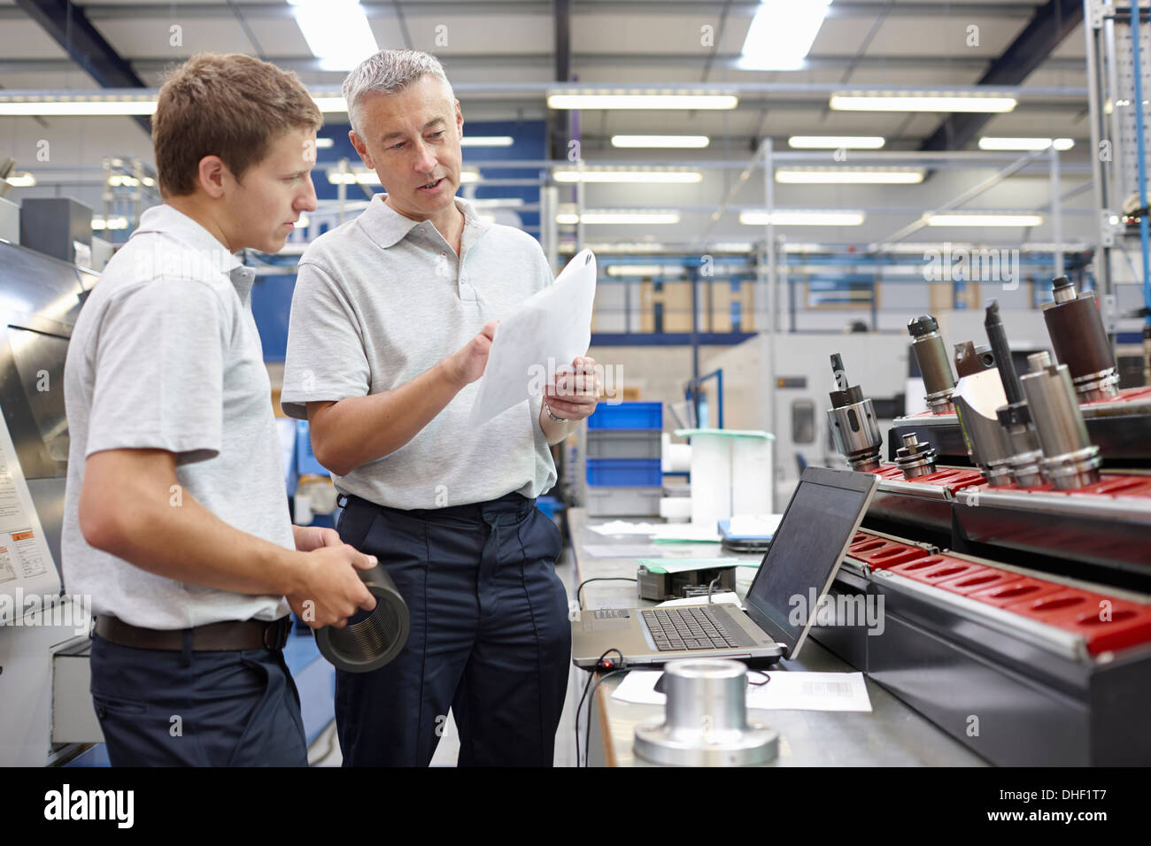 Worker and manager meeting in engineering warehouse - Stock Image