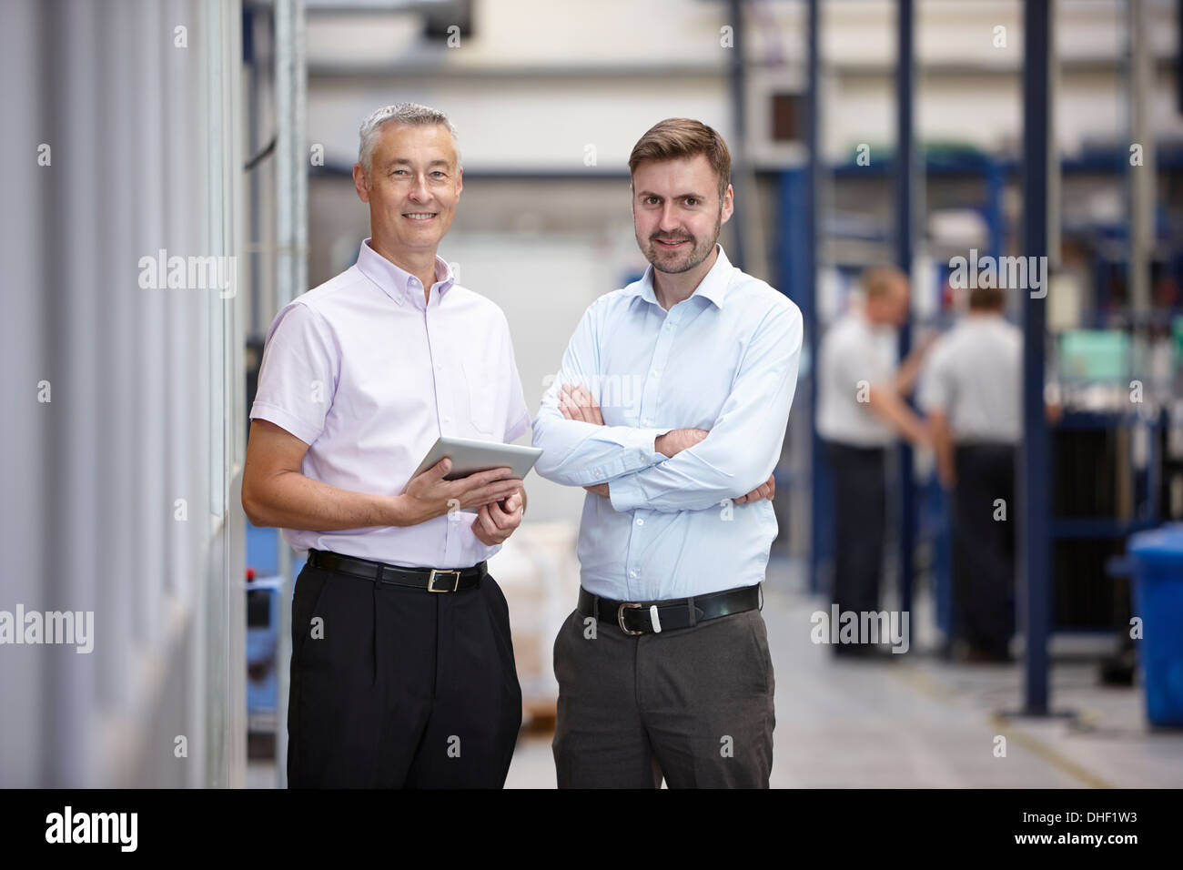 Portrait of two engineers in engineering factory - Stock Image