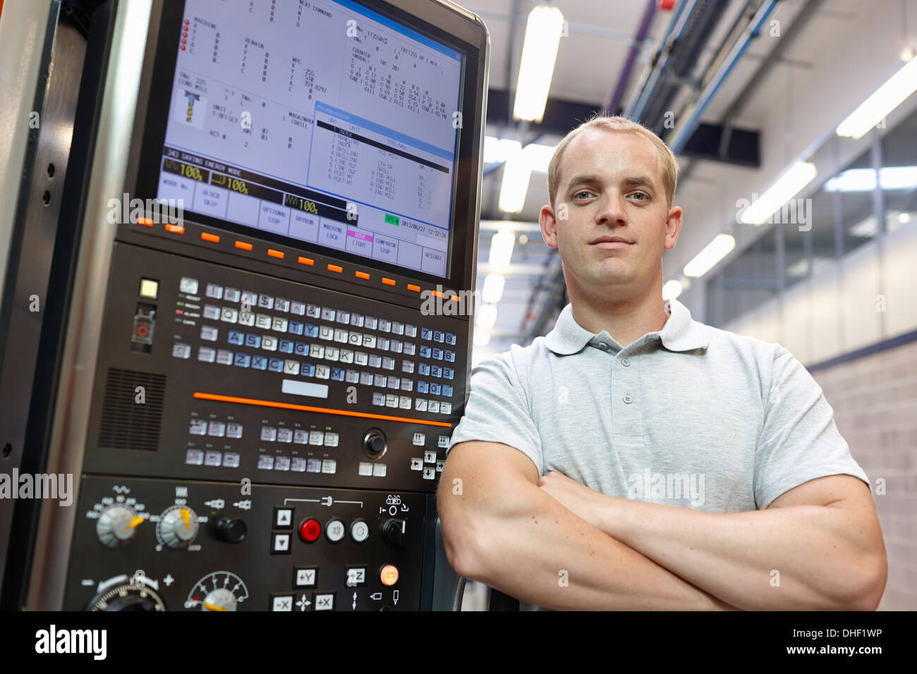 Portrait of engineer and control panel in engineering factory - Stock Image