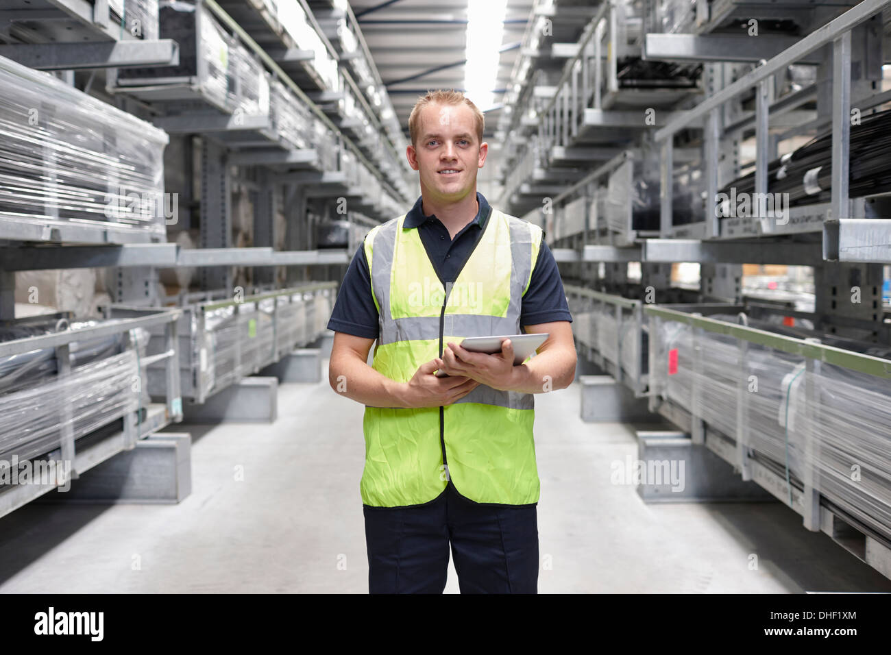 Portrait of worker in engineering warehouse - Stock Image