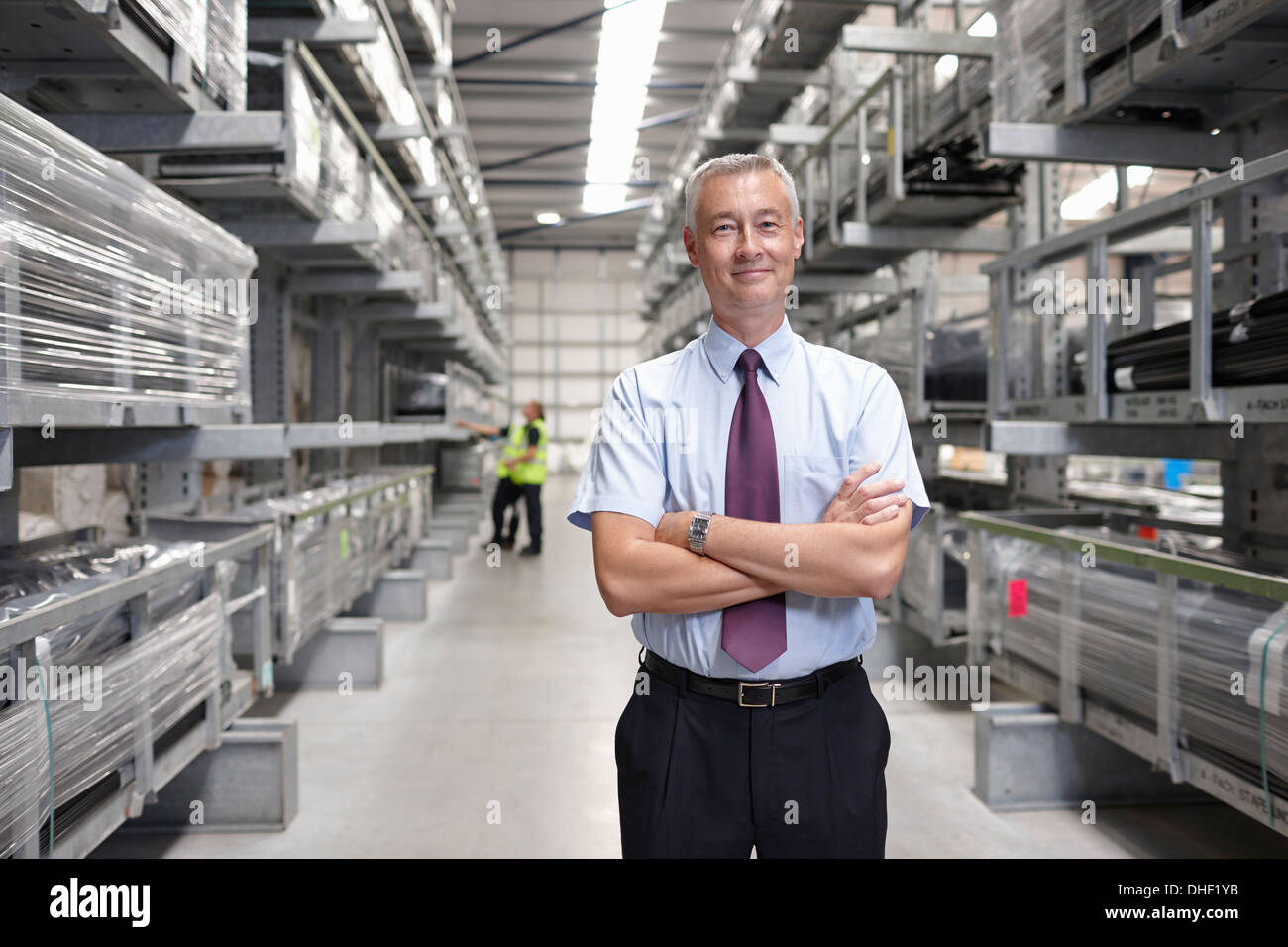 Portrait of manager in engineering warehouse - Stock Image