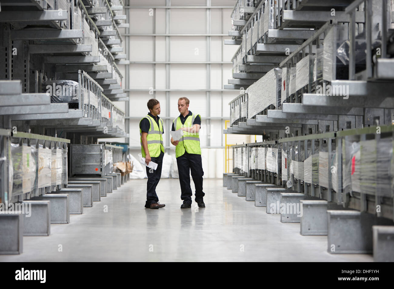 Warehouse workers in engineering warehouse - Stock Image