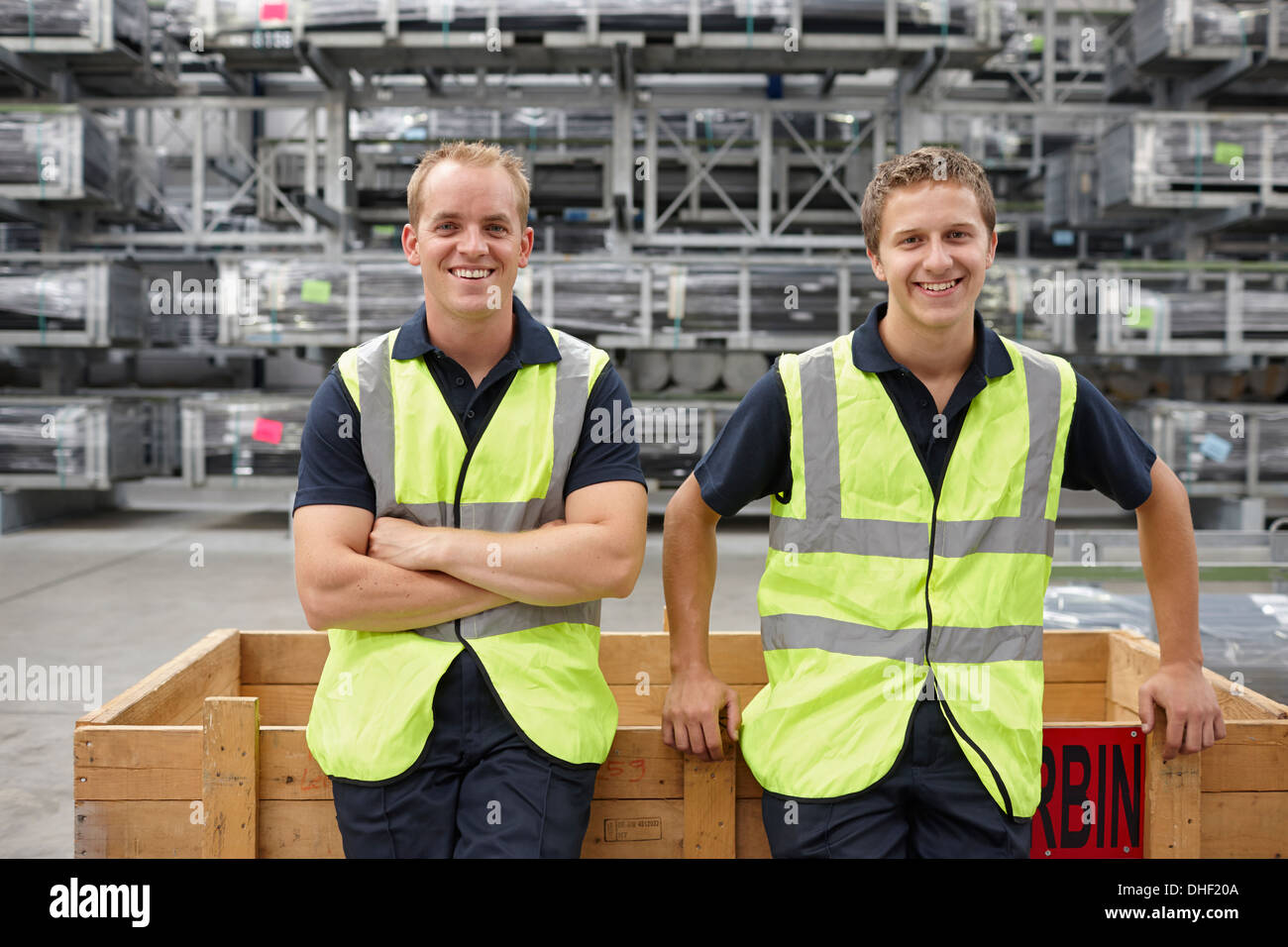 Portrait of warehouse workers in engineering warehouse - Stock Image