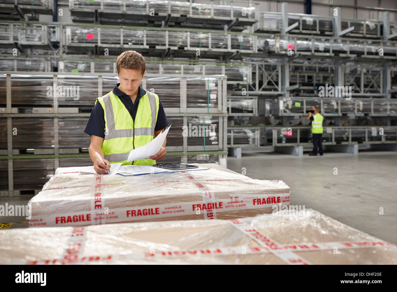 Warehouse worker checking order in engineering warehouse - Stock Image