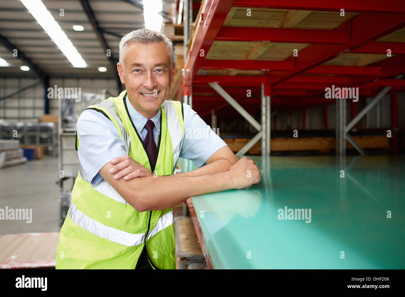 Portrait of warehouse manager in engineering warehouse - Stock Image