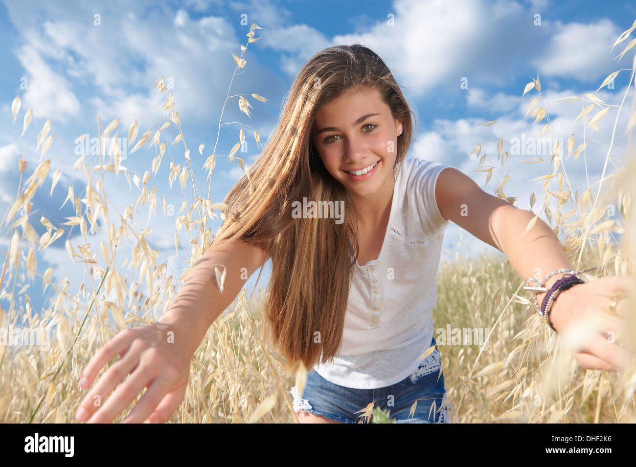 Teenage Girl In Field Parting Crops Tuscany Italy