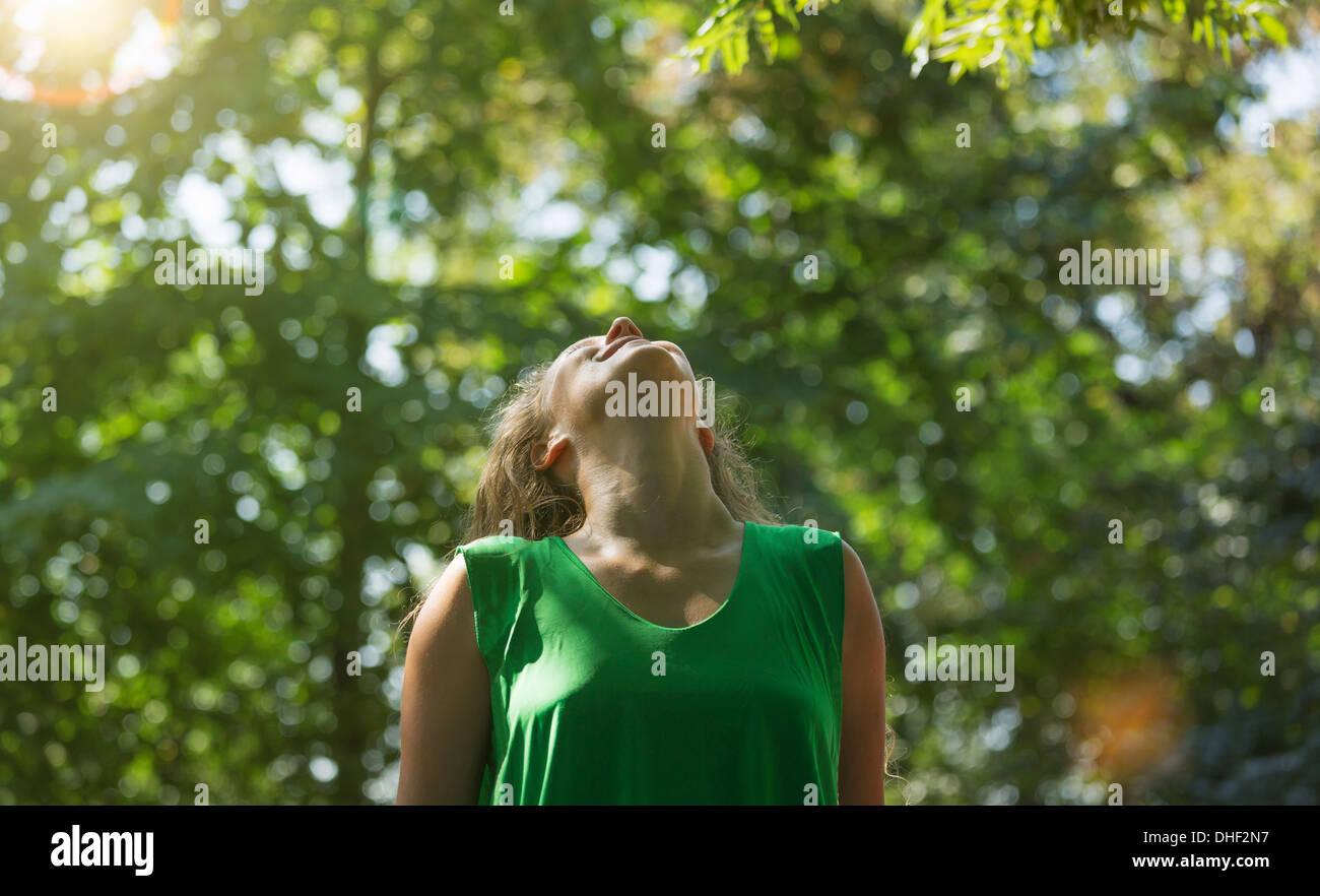 Teenage girl wearing green top looking up, Prague, Czech Republic - Stock Image