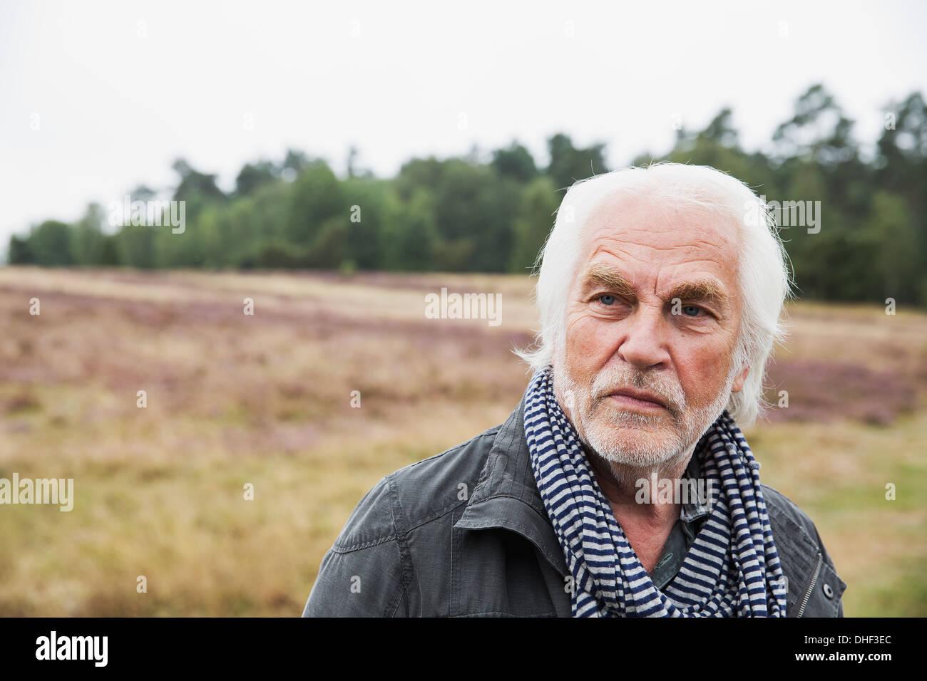 Portrait of senior man with grey hair - Stock Image