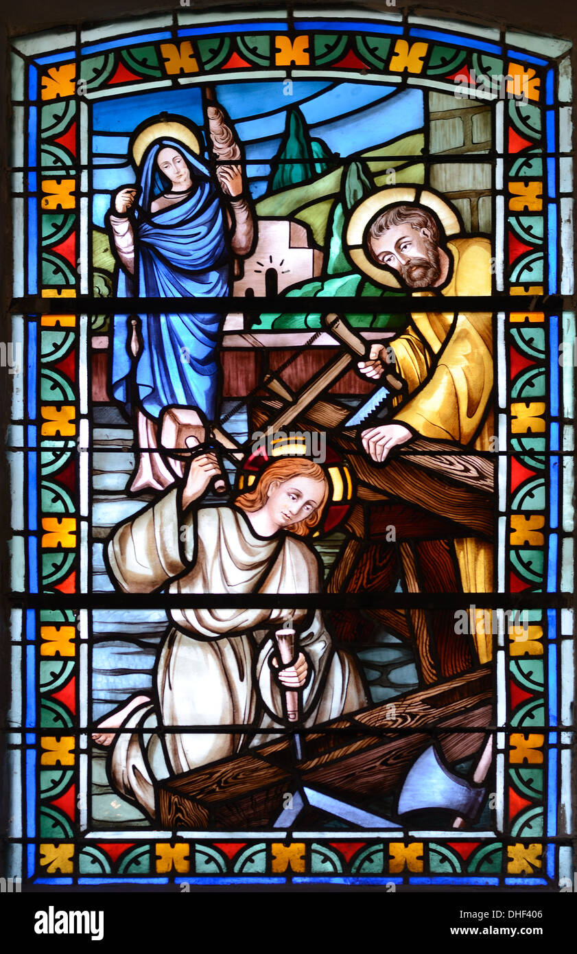 Joseph & Mary Carpenters Stained Glass Church of Thomas Becket Avrieux Maurienne Valley Savoie France - Stock Image