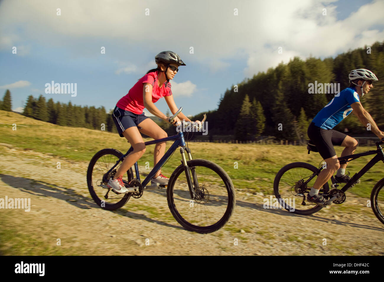 Young woman and man mountain biking, Styria, Austria - Stock Image