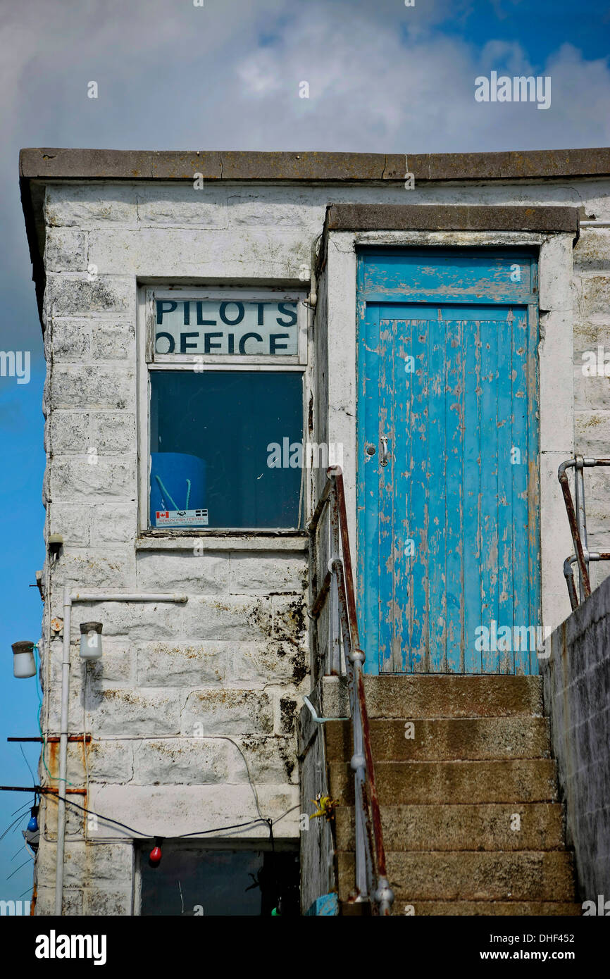 Pilots office, Newlyn Harbour ,Cornwall blue,sky blue door, - Stock Image