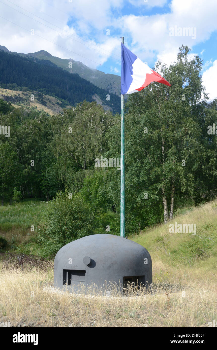 Gun Emplacement Look Out or Cloche & French Flag Saint Gobain Fort on Maginot Line Modane Maurienne Savoie France - Stock Image