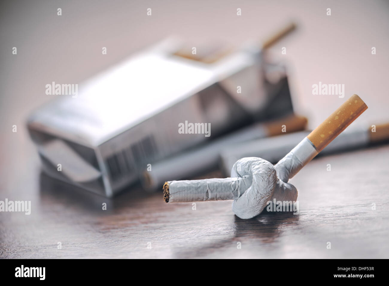 tied cigarette on table closeup - Stock Image