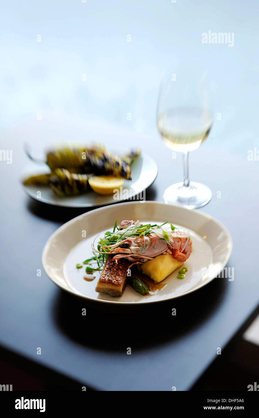 Still life with prawn, potato and micro greens Stock Photo