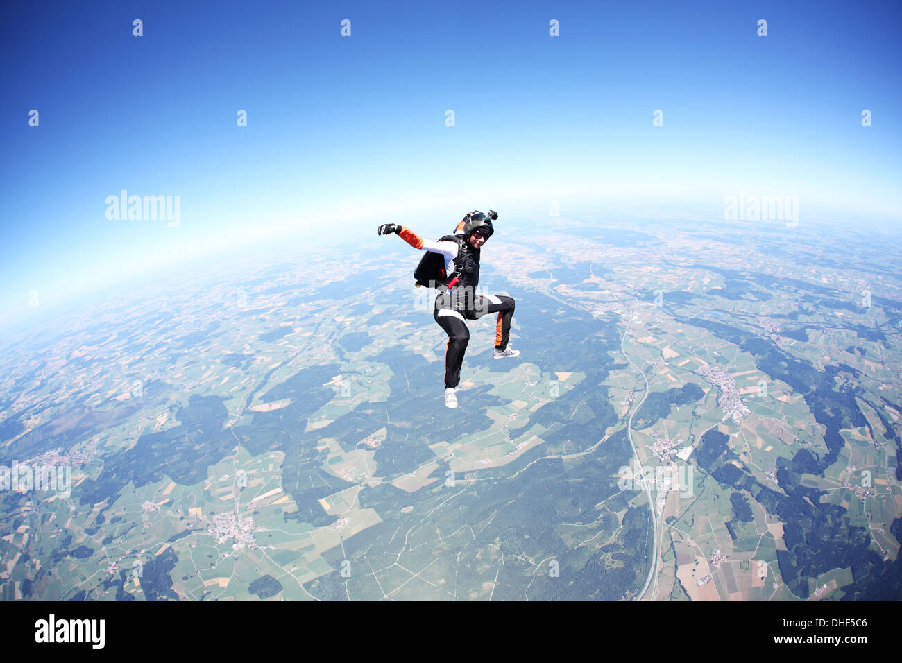 Female skydiver free falling above Leutkirch, Bavaria, Germany - Stock Image