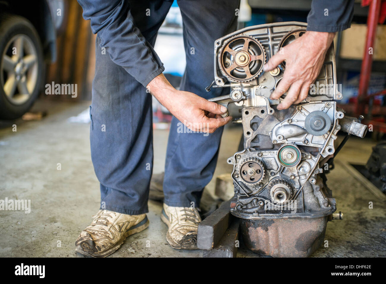 Mechanic working on car part - Stock Image