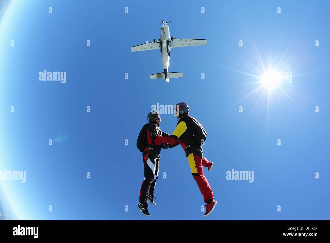 Female skydivers free falling above Leutkirch, Bavaria, Germany - Stock Image