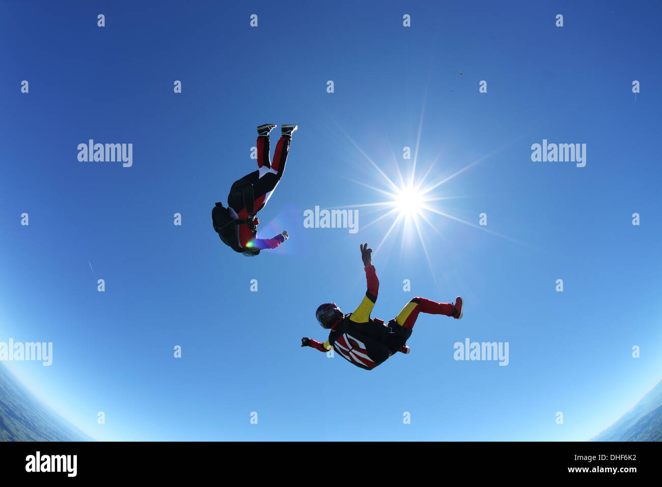 Skydivers upside down above Leutkirch, Bavaria, Germany - Stock Image