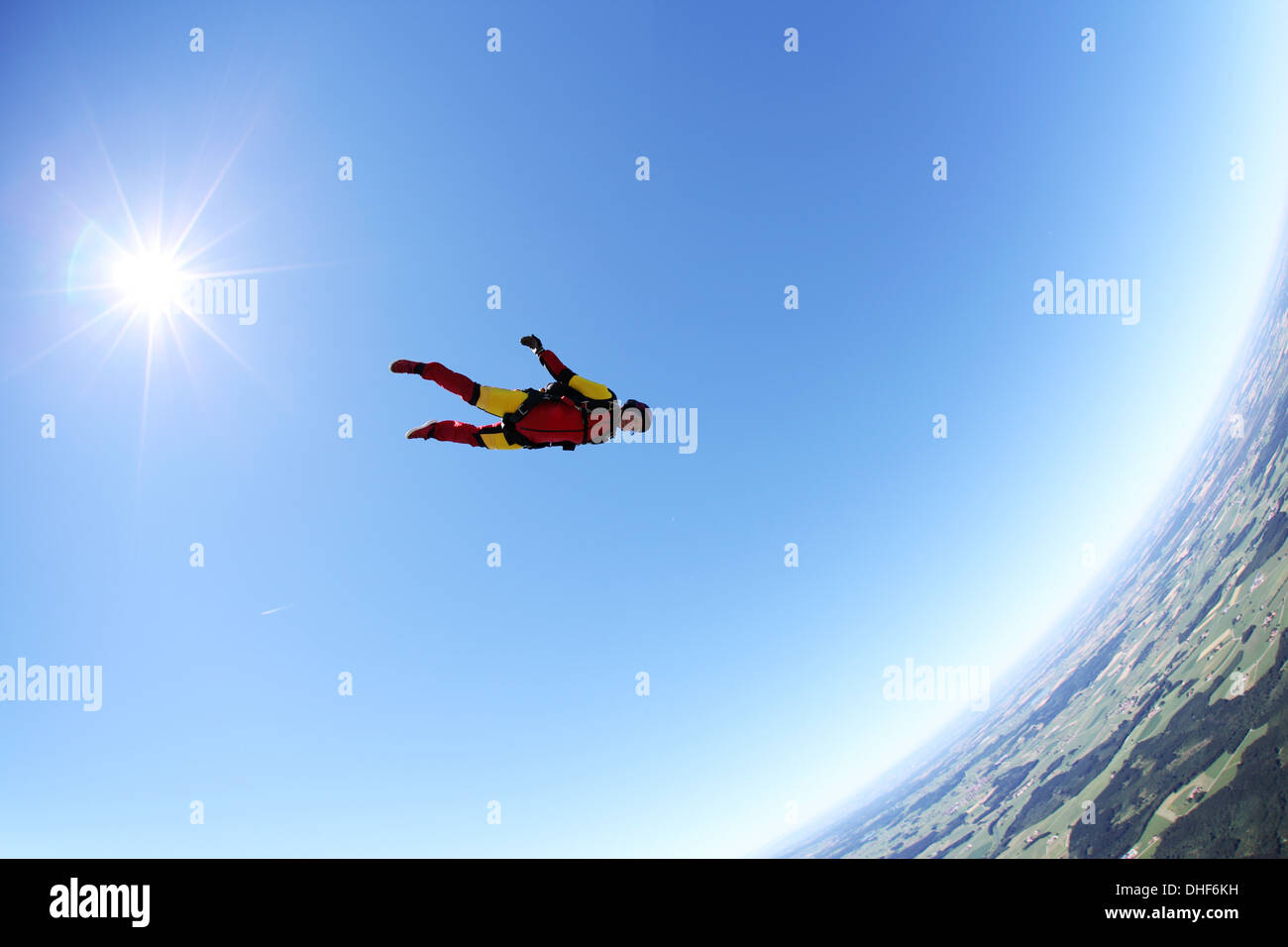Skydiver free falling face down above Leutkirch, Bavaria, Germany Stock Photo