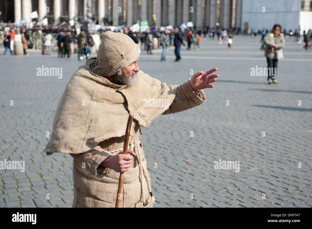 Man in habit in St.Peter's square - Stock Image
