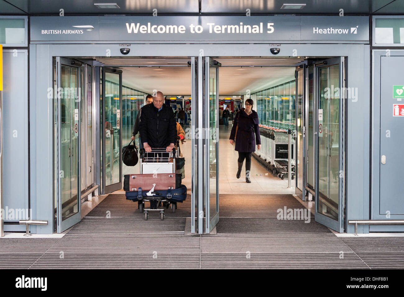 Tourists leave Terminal five and enter United Kingdom. Heathrow Airport, London, England, GB, UK. - Stock Image
