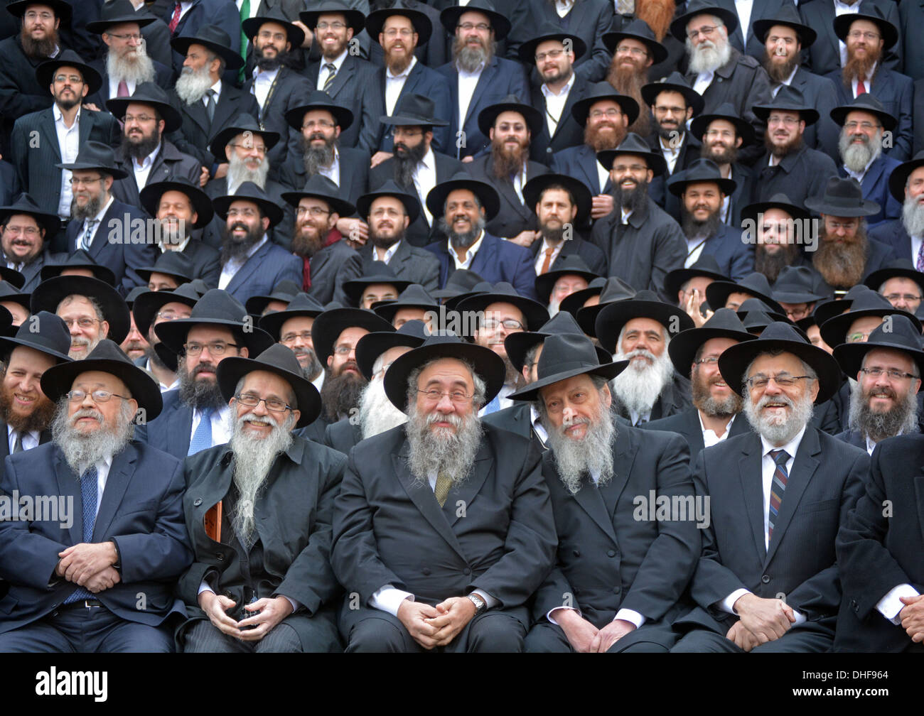 Several rabbis seated preparing for a group photo at the convention of Lubavitch emissaries in Brooklyn, New York 11.3.2013. - Stock Image