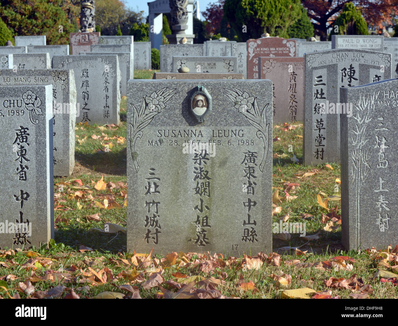 Asian tombstone of a deceased young lady in Cypress Hills Cemetery in Queens, New York - Stock Image