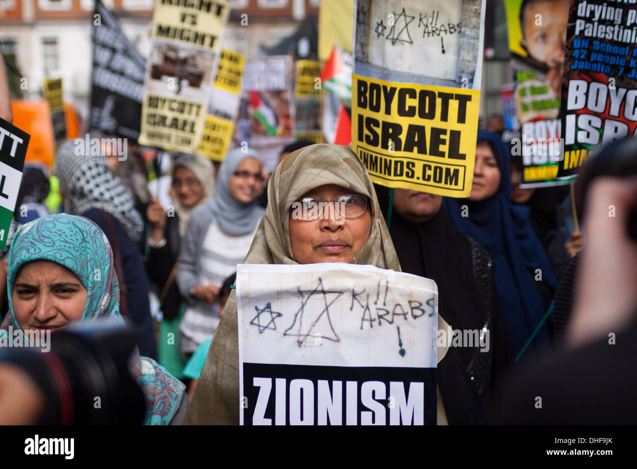 A woman holds a placard at the 2013 Al-Quds day demonstration, London. Al-Quds day is a pro-Palestinian day of protest. - Stock Image