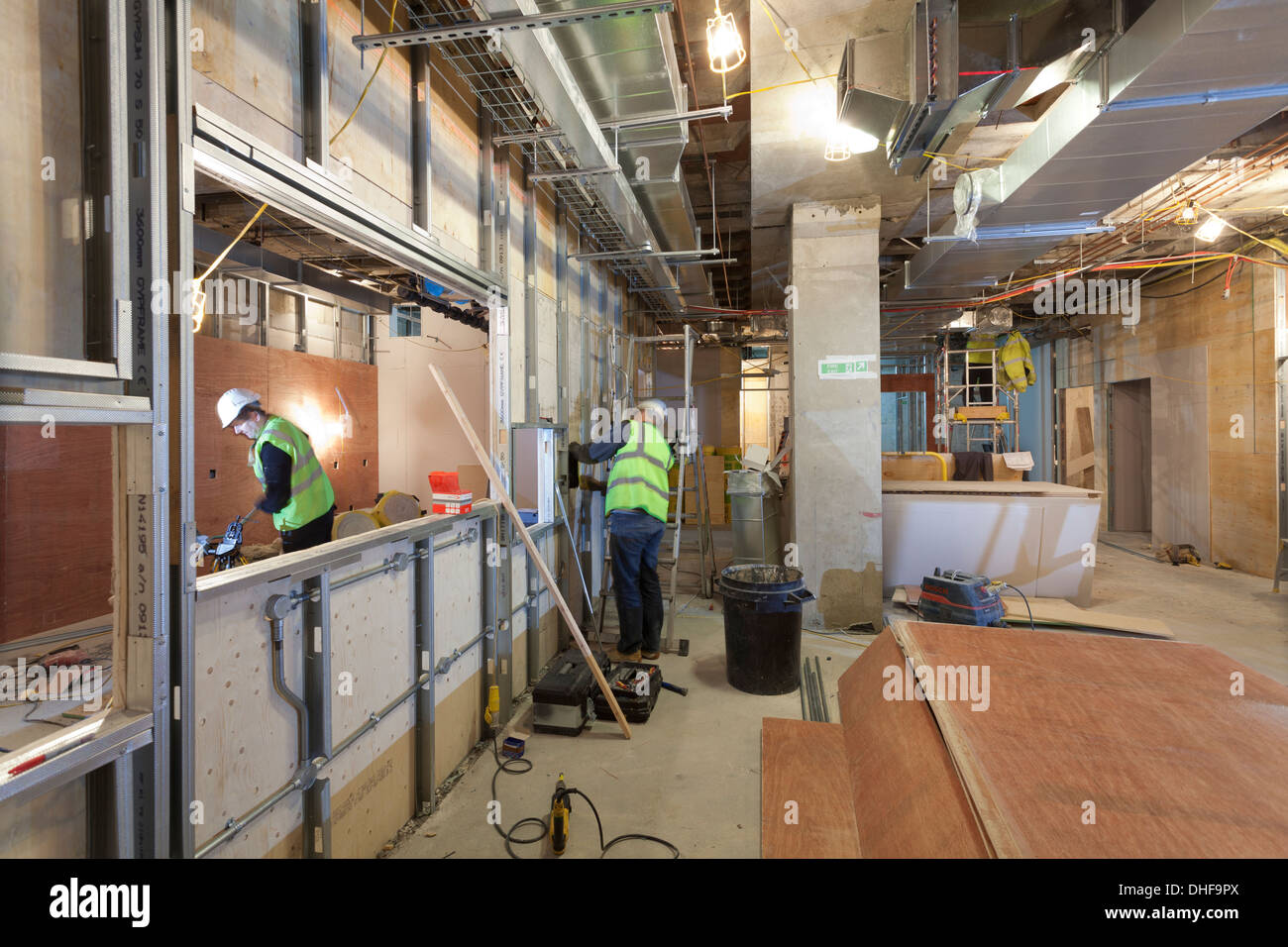 Builders working inside a construction site. - Stock Image
