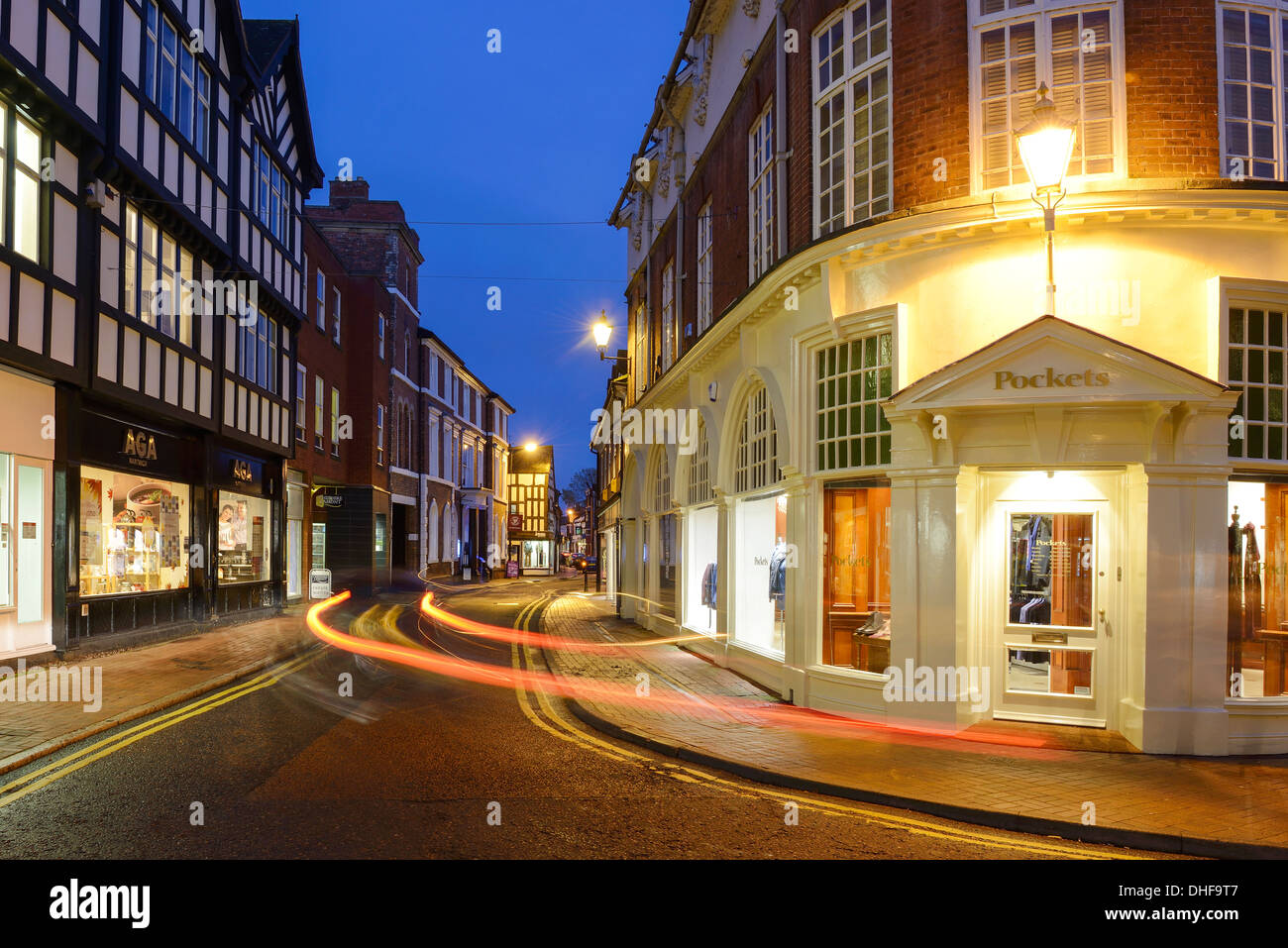 Evening traffic driving through Nantwich town centre in Cheshire UK - Stock Image