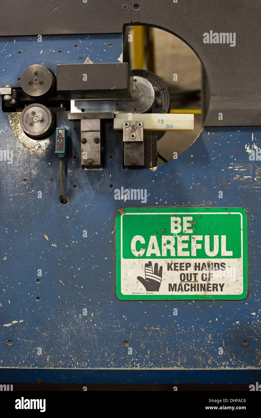 Safety Warning on Machinery at New Era Windows Cooperative - Stock Image