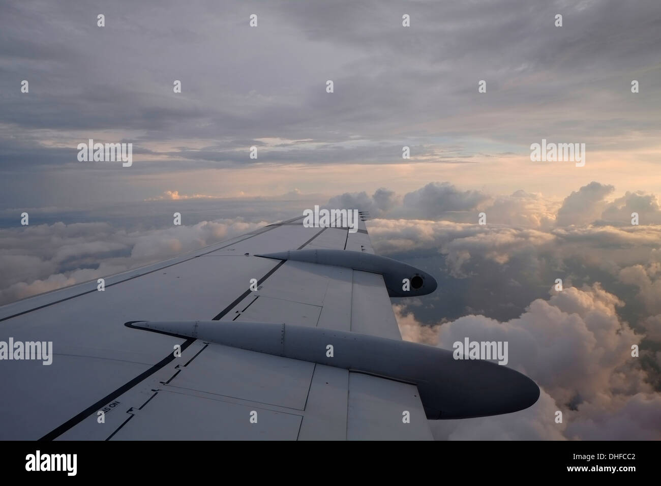 Airplane winglet high up in the sky - Stock Image