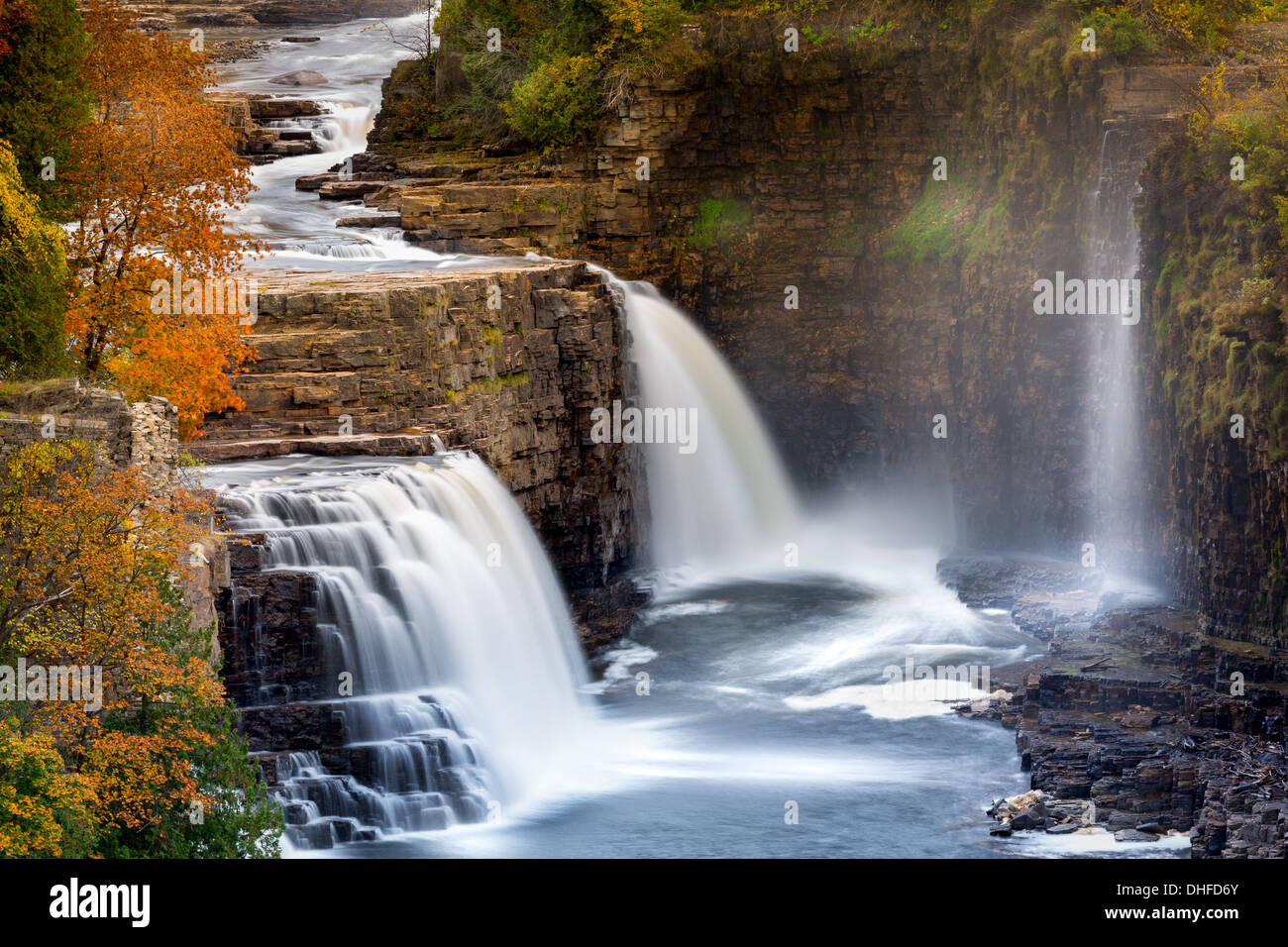 Ausable Chasm Waterfall at the peak of the fall foliage colors - Stock Image