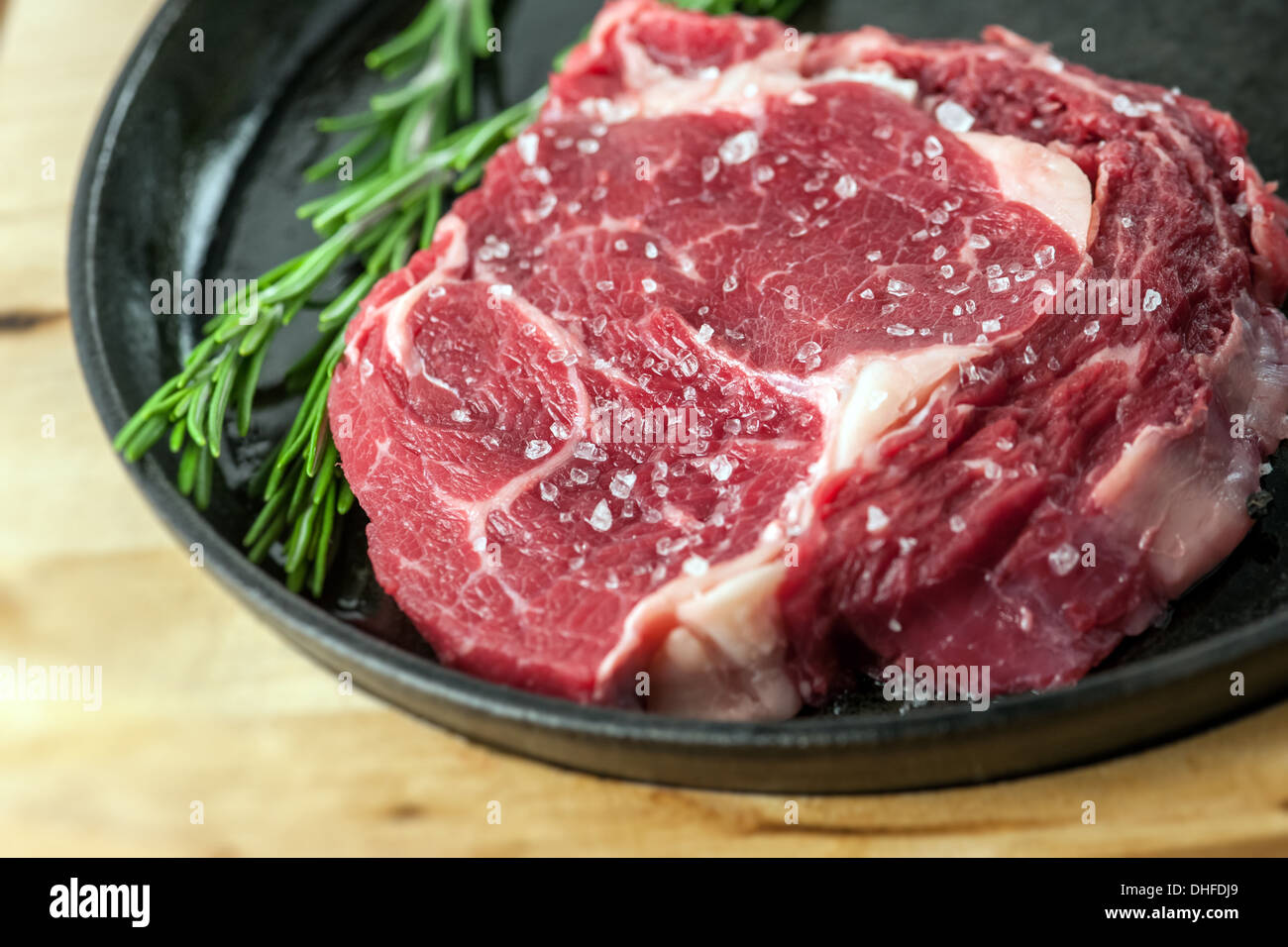 beef piece in frying pan - Stock Image