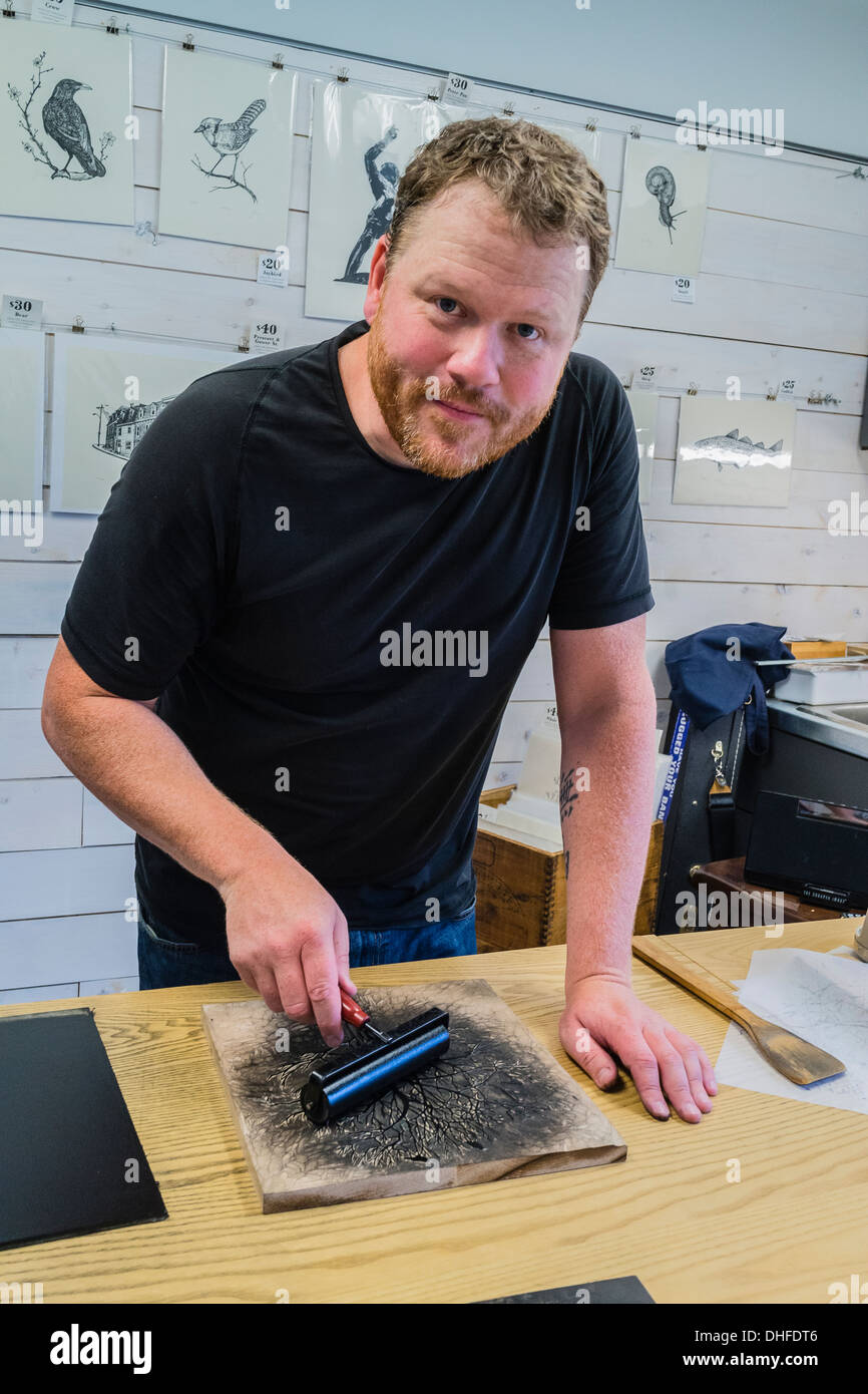 Artist Graham Blair, a woodblock printmaker at his studio in Quidi Vidi in St. John's Newfoundland. - Stock Image