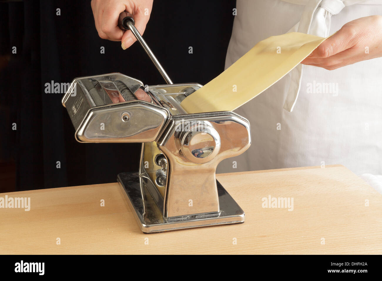 rolling pasta sheets with a machine - Stock Image