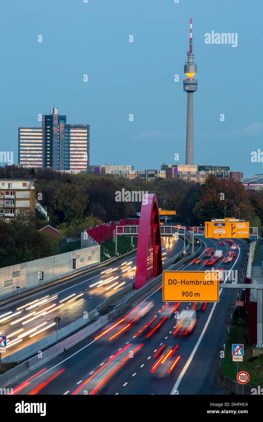 City skyline of Dortmund, Germany. Motorway, Autobahn A40, TV tower 'Florian Turm'. - Stock Image