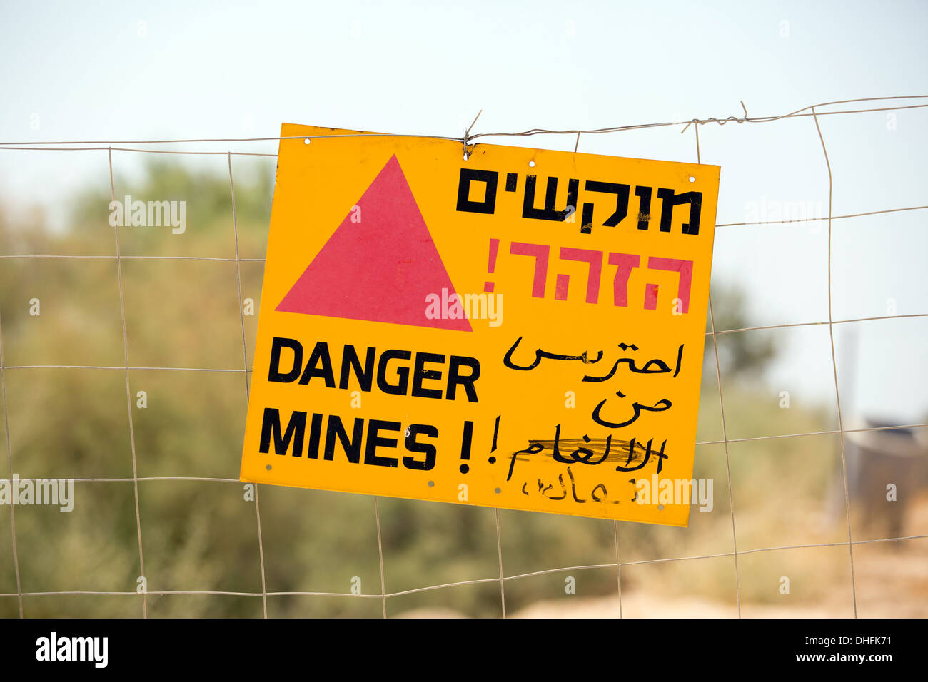 Danger Mines sign on a fence in Israel at Qasr el Yahud site - Stock Image