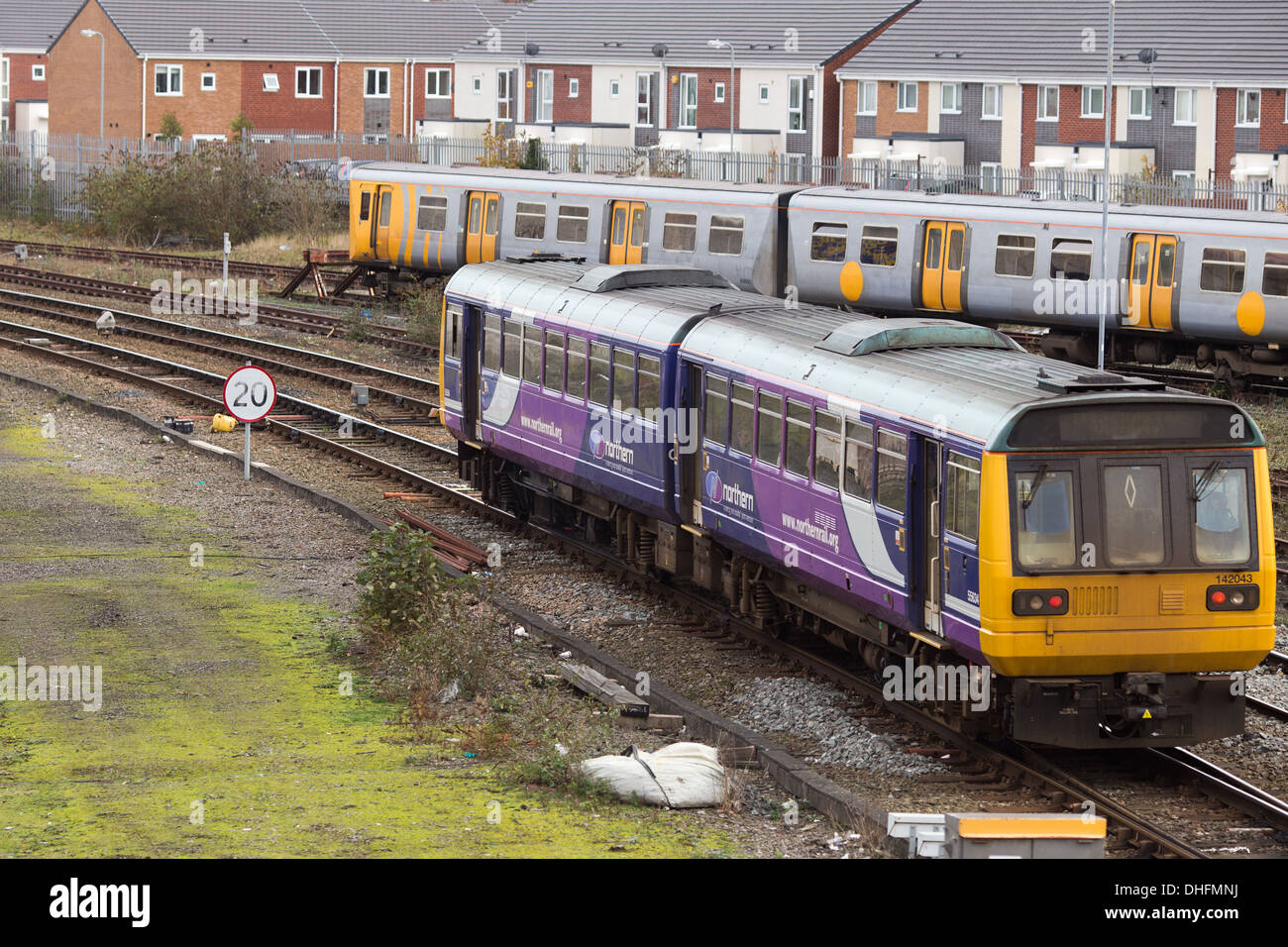 A Northern Rail train leaves Southport Train Station - Stock Image